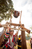 Akha woman in traditional dress playing Akha Swing Festival. CHIANG RAI,THAILAND-AUGUST 30 : The Akha hill tribe minority swing in the air as they honour their Royalty Free Stock Photos