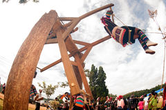 Akha woman in traditional dress playing Akha Swing Festival. CHIANG RAI,THAILAND-AUGUST 30 : The Akha hill tribe minority swing in the air as they honour their Stock Photos