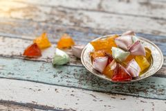 Akide sugar candies on old metallic plate on vintage table Stock Images