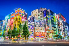 Akihabara Tokyo. TOKYO, JAPAN - AUGUST 1, 2015: Crowds pass below colorful signs in Akihabara. The historic electronics district has evolved into a shopping Stock Photos