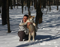 Akita Inu. Puppie of Japanese dog Akita Inu,wth his owner,Belgrade,Serbia.First steps on the snow Stock Photos