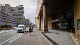 Street in Akita City, Tohoku, Japan. Akita, Japan - May 18, 2017. Vehicles and people on street at downtown in Akita, Japan. Akita is a large prefecture at the royalty free stock image