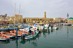 Akko, Israel. MARCH 28, 2015: View at marina and old town of Akko at twilight time. Akko (Acre), one of the major tourist attraction of northern Israel Stock Photography