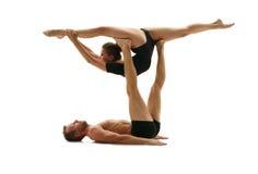 akrobat Man och kvinna som gör splittringar i service Fotografering för Bildbyråer