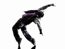 Akrobatischer Breakdancer des Hip-Hop, der Schattenbild des jungen Mannes breakdancing ist Stockfotos
