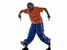 Akrobatischer Breakdancer des Hip-Hop, der Schattenbild des jungen Mannes breakdancing ist Lizenzfreie Stockfotos