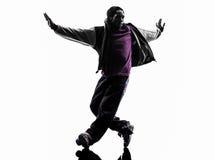 Akrobatischer Breakdancer des Hip-Hop, der Schattenbild des jungen Mannes breakdancing ist Lizenzfreie Stockbilder