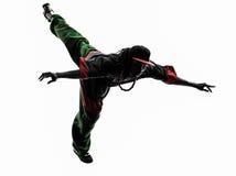 Akrobatischer Breakdancer des Hip-Hop, der springendes Si des jungen Mannes breakdancing ist Lizenzfreie Stockfotografie