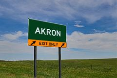 US Highway Exit Sign for Akron. Akron composite Image `EXIT ONLY` US Highway / Interstate / Motorway Sign Royalty Free Stock Images