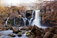 Akron Falls. Park is a small park in the Village of Akron, NY, with a wonderful waterfalls.  Murder Creek makes its way over the falls Royalty Free Stock Photography