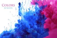 Akrylfärger i vattenbakgrund royaltyfri bild
