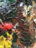 Akrylmålarfärg och borste Arkivfoton