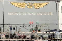 Akta sig av stråltryckvåg, och rotorer undertecknar på däcket av USSet Bonhomme Richard Royaltyfri Foto