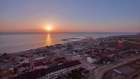 Aktau city on the shore of the Caspian Sea at sunset timelapse. Kazakhstan. Aktau city on the shore of the Caspian Sea at sunset timelapse. Aerial top view from stock footage