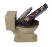Aktenkoffer in der Toilette Lizenzfreie Stockbilder