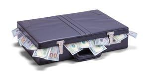 Aktentas met geld die uit plakken royalty-vrije stock foto
