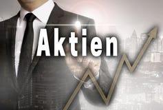Aktien en partes alemanas es mostrado por concepto del hombre de negocios fotos de archivo libres de regalías