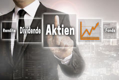 Aktien in german shares, dividend, fund, yield Businessman wit. H city background concept Stock Photo