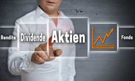 Aktien in germn Shares, Dividend, Yield, Fund concept backgrou. Nd is shown by man Royalty Free Stock Photos