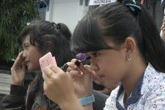AKTIONS-UND BLICK-HÜBSCHE DORF-MAKE-UPstudenten FÜR INDONESIEN 2014 lizenzfreies stockfoto