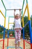Aktiv liten flicka på lekplats Royaltyfria Bilder