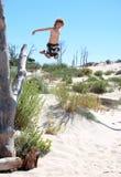 aktiv pojke som ut hoppar treebarn royaltyfri bild
