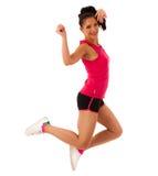 Aktive Frau, die Aerobic für ein Herz Trainingstanzen tut Lizenzfreies Stockfoto