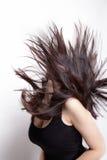 Aktive Frau mit dem Haar in der Bewegung Stockfotografie