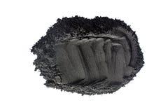 Aktiverat kolpulver som skjutas med makrolinsen Arkivbilder