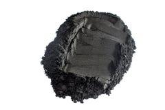 Aktiverat kolpulver som skjutas med makrolinsen Royaltyfri Bild