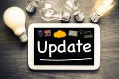 Aktualisierung auf Tablet Stockfotos