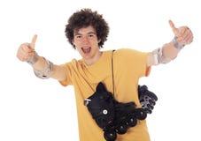 Aktywna rolkowa chłopiec z rolkowymi łyżwami. Obrazy Royalty Free