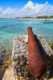 Akumal beach rusted canon in Riviera Maya. Akumal beach rusted iron canon in Riviera Maya of Mayan Mexico royalty free stock photo