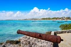Akumal beach rusted canon in Riviera Maya. Akumal beach rusted iron canon in Riviera Maya of Mayan Mexico stock photo
