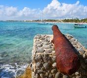 Akumal beach rusted canon in Riviera Maya. Akumal beach rusted iron canon in Riviera Maya of Mayan Mexico royalty free stock image
