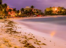 Akumal Mexico. Beach at night with lights on from the villa`s Royalty Free Stock Photos