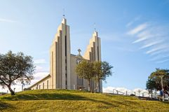 Akureyrarkirkja, church of Akureyri, Iceland. Designed by Gudjon Samuelsson, is an architectural landmark visited by people from all of the world Stock Photos