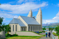 Akureyrarkirkja church, in Akureyri. AKUREYRI, ICELAND - JUNE 17, 2016: View of the Akureyrarkirkja church, with Locals and visitors, in Akureyri, Iceland Royalty Free Stock Photo