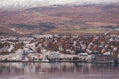 AKUREYRI, ICELAND - OCTOBER 19, 2014: Akureyri City Cityscape with Port, Gulf, Bay, and Snowy Mountain. Iceland. Stock Image