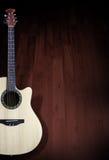 Akustikgitarrehintergrund Stockfoto