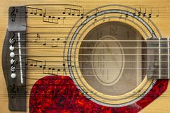 Akustikgitarremontage stockbild