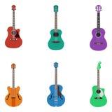 Akustiska gitarrer på kulör bakgrund Arkivfoton