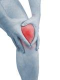 Akut smärta i ett manknä. Manlig innehavhand till fläcken av knä-ACH Arkivfoto