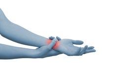 Akute Schmerz in einem Frauenhandgelenk Stockfotos