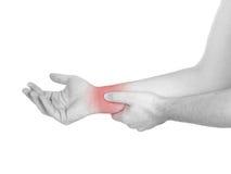 Akute Schmerz in einem Mannhandgelenk. Männliche haltene Hand zur Stelle von Handgelenk-PA Stockbild
