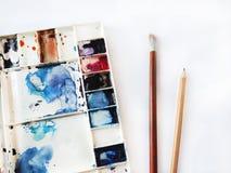 Akwarela setu narzędzia z muśnięciem, ołówek, gumka Obraz Royalty Free