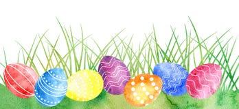 Akwareli Wielkanocni jajka przy zieloną trawą royalty ilustracja