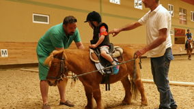 AKYAKA - TURKEY, MAY 2015: little kid learning horse riding stock video footage