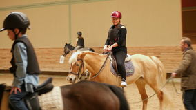 AKYAKA - TURKEY, MAY 2015: woman learning horse riding stock video footage