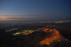 Al Ain City. Mubazara Area in Al-Ain City With Hafeet Mountain Road at night Royalty Free Stock Photo